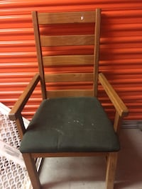 Black wooden framed black leather padded chair