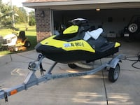 black and yellow personal watercraft