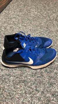 Pair of blue nike running shoes Fall River, B2T 1P5