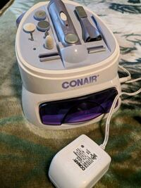 white and purple Conair electronic device set