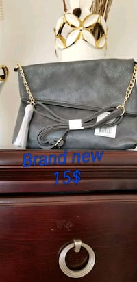black leather sling bag with text overlay Brampton, L6R