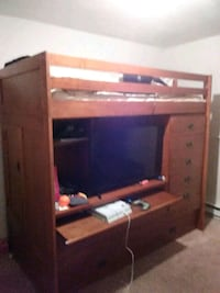 brown wooden TV hutch with flat screen television Clarksville, 37042