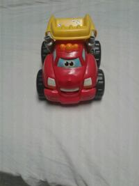 red and yellow dump truck toy