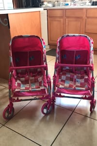 Two pink double doll strollers with basket for sale. Halifax, B3T 1S7