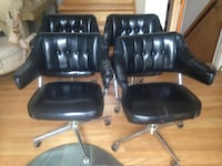4 mid century chairs with castors