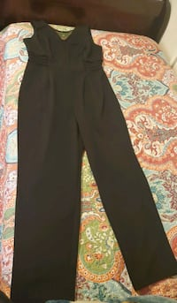 Black Jumpsuit. Product of good quality and is in  Washington, 20011