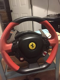 Black and red ferrari steering wheel game controller Wallaceburg, N8A 2T6