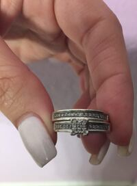 silver-colored engagement rings