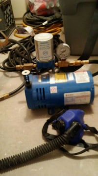 blue and black air compressor