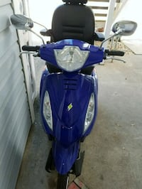 black and blue mobility scooter