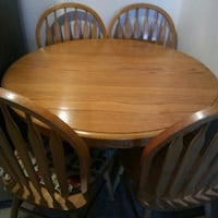 oval brown wooden table with four chairs dining set Englewood, 80112