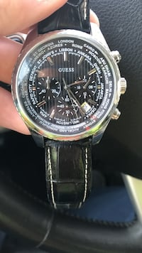 Round silver-colored guess chronograph watch with black leather strap Winnipeg, R3K 2G6