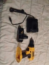 black and yellow DeWalt cordless power drill 69 km
