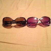 two over-sized pink and brown plastic framed sunglasses