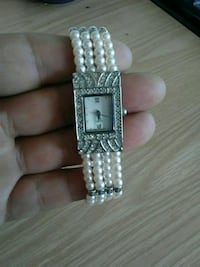 square silver analog watch with silver link bracelet