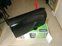 black and green power tool