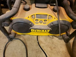 Dewalt radio with battery built in charger and aux  100 cash today