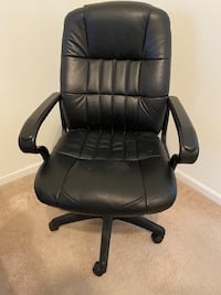 Black, faux leather office chair. Adjustable height and swivels.