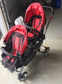 Baby's red and black stroller  Bradford West Gwillimbury, L3Z 0X5