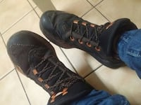 pair of black-and-orange Under Armour lace-up shoes