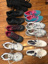 Assorted color pairs of black,teal and white athletic shoes Melville, S0A