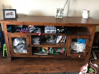 brown wooden TV stand with flat screen television Costa Mesa, 92626