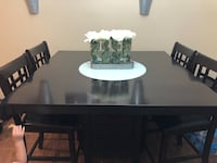 Rectangular brown wooden table with four chairs dining set Woodbridge Township, 07095