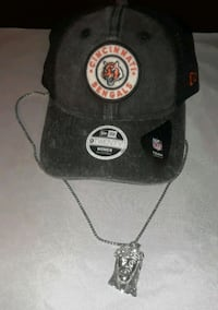 black and gray fitted cap and chsin 300 mi
