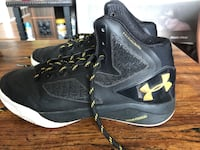 Pair of black under armour basketball shoes