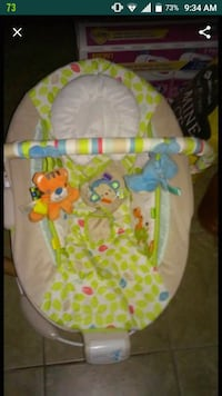 baby's white and green bouncer Dallas, 75243