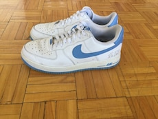 white-and-blue Nike Air low-top sneakers