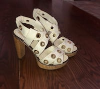 pair of white-and-brown leather sandals Laval, H7H 1Y5