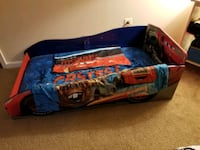 Race car bed with sheets