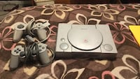 gray Sony PlayStation with game controllers Easton, 18040