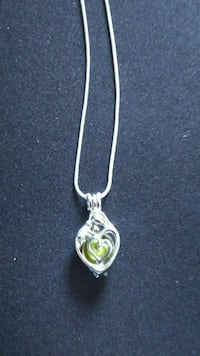 green gemstone silver-colored heart pendant necklace