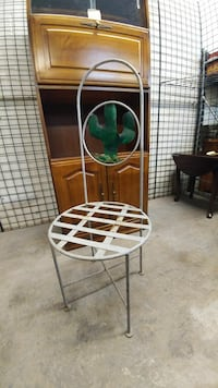 white and green metal chair
