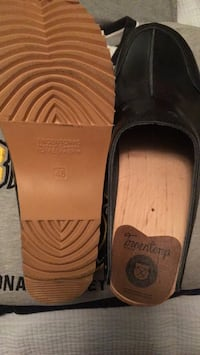 pair of black slide sandals 248 mi