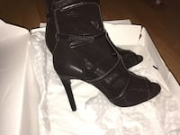 pair of black leather open-toe heeled booties with box 3156 km