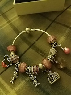 silver and brown charm bracelet
