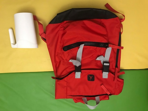 Big red back pack c337ed44-d9f1-406a-8c66-c566bf0efe68