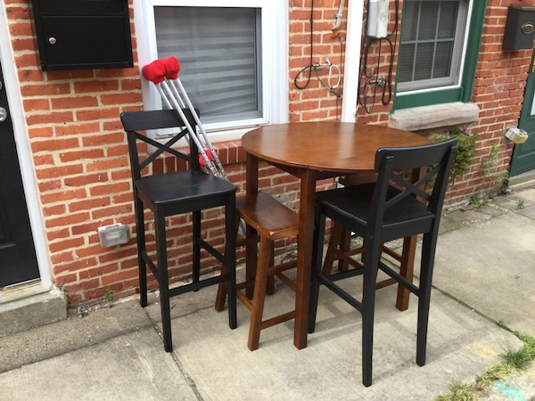 Tall table and 4 chairs + 2 crutches = FREE. Currently curbside outside 2005 Portugal St. Thank you. 8214d7a4-b799-4048-9c79-899843f3a23e