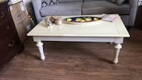 White wooden coffee table with two white throw pillows Arlington, 22204