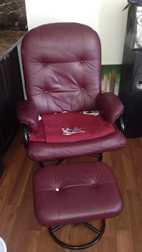 red leather padded rolling armchair Calgary, T2T 4L9