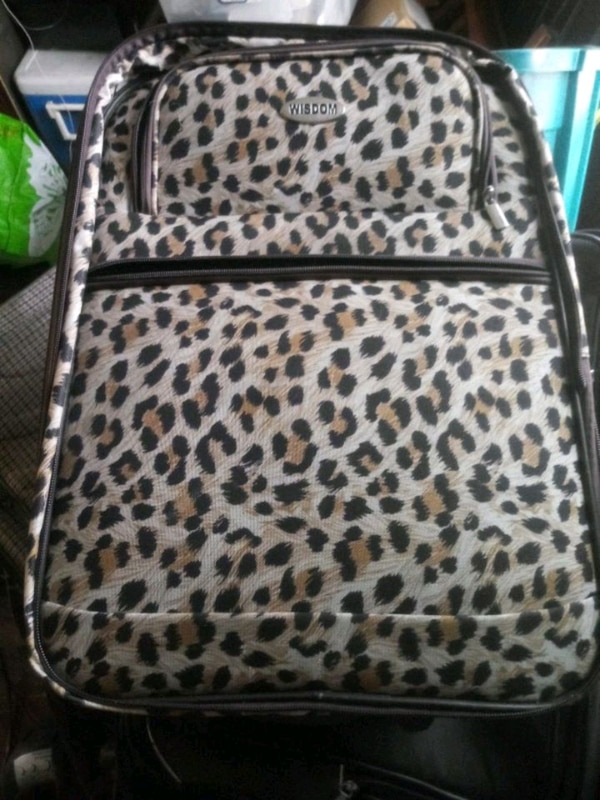 Used brown and black leopard print backpack for sale in Queens - letgo 40160ace611be