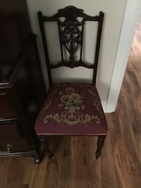 brown wooden framed red and white floral padded chair