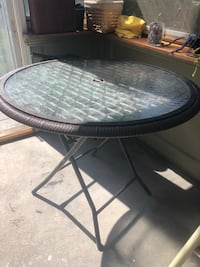 round black metal framed glass top patio table Taunton, 02780