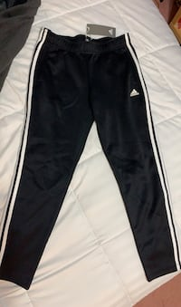 Brand new Adidas tear away pants with double white lines on the sides  Mississauga, L5L