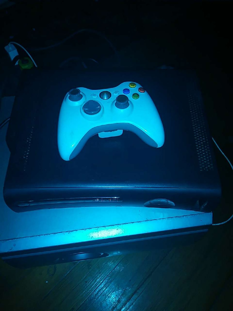 black XBOX 360 S console with controller