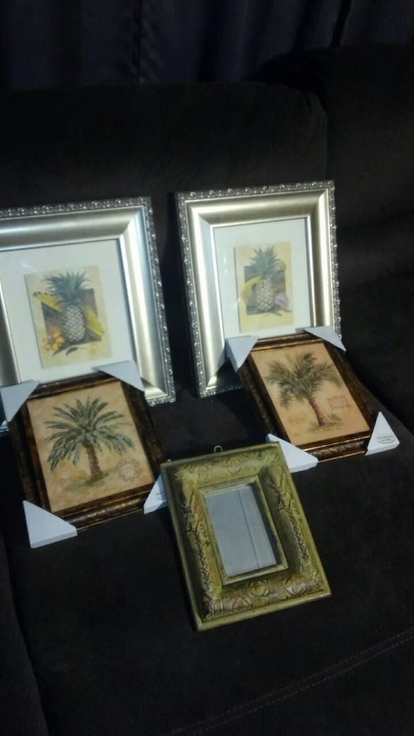 Pineapple picture frames and small hallway mirror