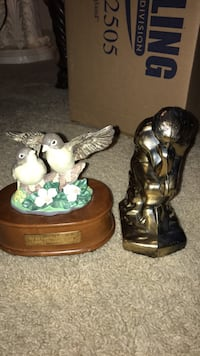 two brown and green ceramic figurines 400 mi